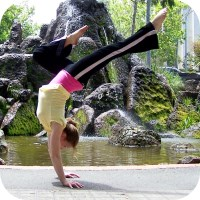 Exercise and Fertility: Woman performing handstand